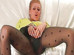 turned on blonde in black pantyhose sticks dildo