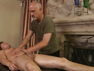 muscled tattooed gay obtains oiled and massaged