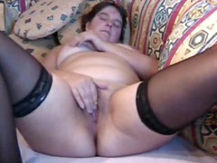 plump woman plays to orgasm