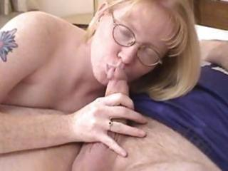 albino mature babe putting on glasses blows and
