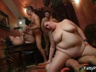 chubby lady gets two dicks at once