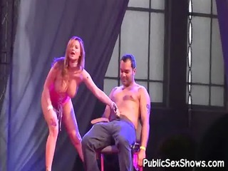 naughty redhead inserts a toy into her cunt
