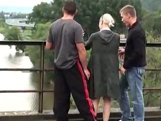 public river bridge three people