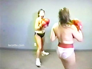 Two busty goddesses wrestling and boxing