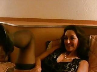 ebony haired brunette older  with big bosom poses
